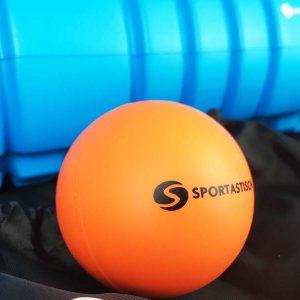 Hier siehst du den orangefarbenen Massageball